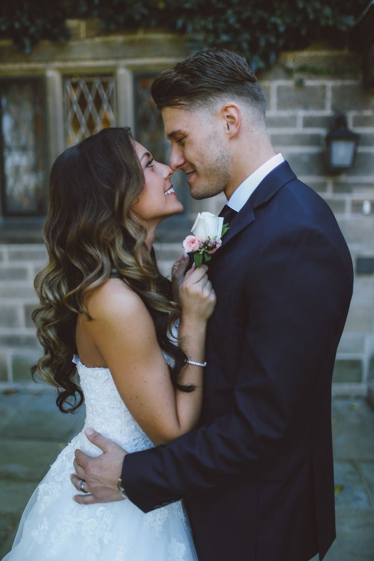 Wedding Photography in Windsor Ontario - Bride holds on tight to Her Groom - Curescu Photography