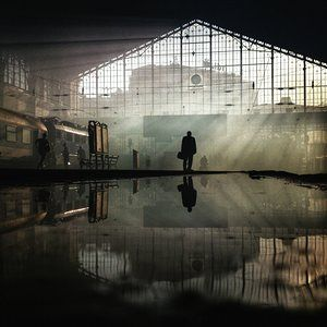 Sunset at Nyugati Railway Station in Budapest, by Janos M Schmidt, Hungary  'A man watching the timetable in the deserted platform of Nyugati station, right after the train carrying Hungarian fans to the Romania-Hungary football match in Bucharest has departed. The sunset is seen through the smoke of all the firecrackers exploded by the football fans' Second place, Mobile Phone Award