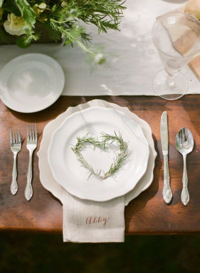 herb wreaths at each place setting Photography by White Loft Studio / whiteloftstudio.com/