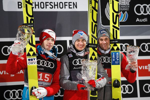 Kamil Stoch (C) of Poland celebrates winning the Bischofshofen competition with Michael Hayboeck (L) of Austria and  Piotr Zyla of Poland on Day 2 of the 65th Four Hills Tournament ski jumping event at Paul-Ausserleitner-Schanze on January 6, 2017 in Bischofshofen, Austria.