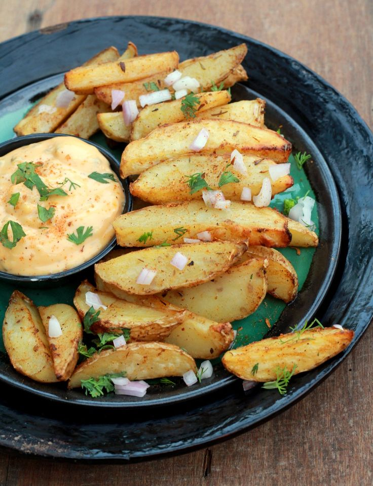 Here are potato wedges spiced up in Cajun spice mix and baked in the oven instead of deep frying. Its a delicious snack; just top it up with some chopped onions herbs and mayonnaise or tomato sauce. Serve it as a party appetiser or as a tea time snack. Recipe by Madhuli. --> http://ift.tt/1sguSz9 #Vegetarian #Recipes