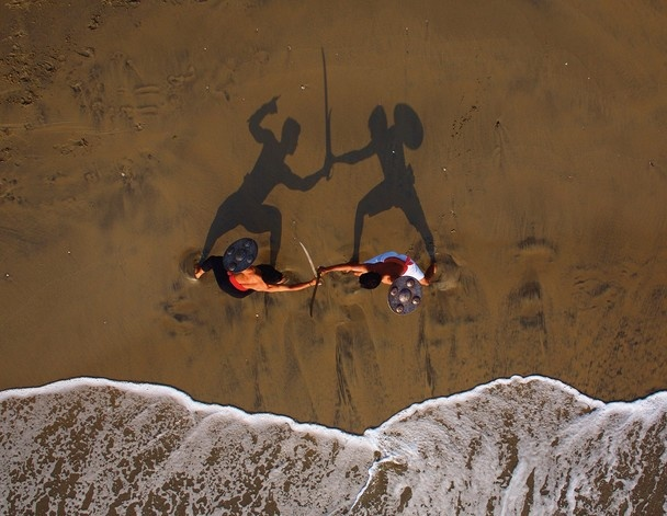Kalari fighters on the beach in North Kerala. It would be memorable to watch such a performance. Right? Watch Kalaripayattu demonstration with us at www.indusholidays.in