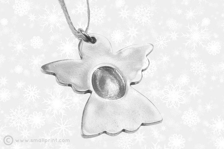 Fingerprint on large angel shape Christmas decoration by Smallprint. www.smallprint.co.za