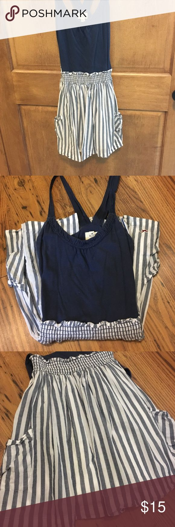 Blue and white striped mini dress The blue part is like a halter top that connects to a flowy blue and white striped skirt. The skirt has pockets. Hollister Dresses Mini