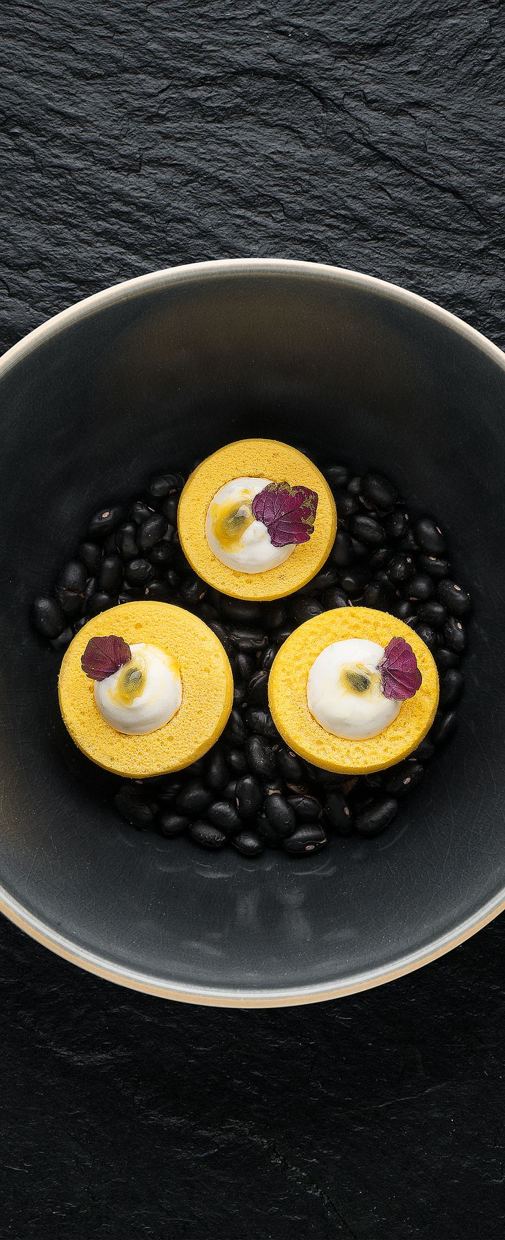 Passionfruit crisps with yoghurt and shiso. 2 Michelin Restaurant Aan de Poel Amstelveen The Netherlands. Food Photography Amuse