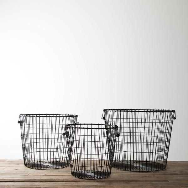 These simple and durable black baskets are theperfect catch-all for laundry, children's toys, or even throw blankets beside the couch. Joanna likes to put one