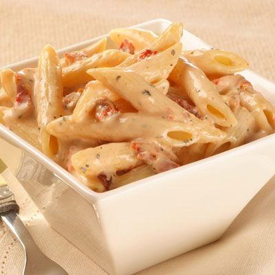 Penne Pasta with Sun-dried Tomato Cream Sauce.  The sauce takes almost  no time at all to make.  Mix, heat, and serve over pasta.  Way better than the prepackaged stuff and a great go-to side.