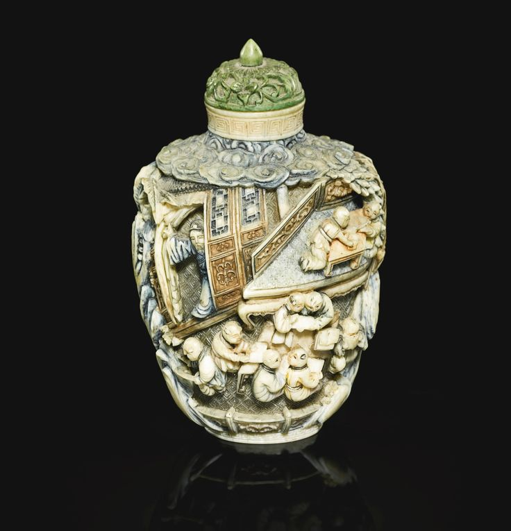 A painted ivory 'boys' snuff bottle, Qing dynasty, 19th century, the ovoid body carved in high relief with scenes of boys at play and studying amongst elaborate interiors framed by jagged rockwork and trees, all below stylised ruyi clouds, the neck and foot encircled by keyfret borders, the stopper decorated with floral scrolls