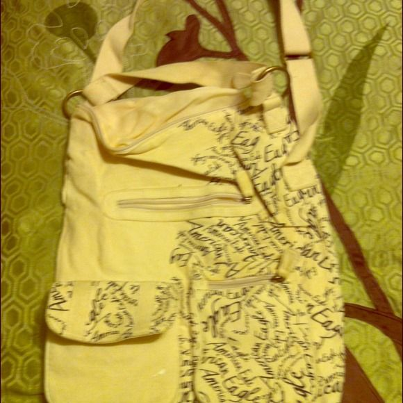 American Eagle tote Large, previously loved American Eagle tote. Lots of pockets. American Eagle Outfitters Bags Totes