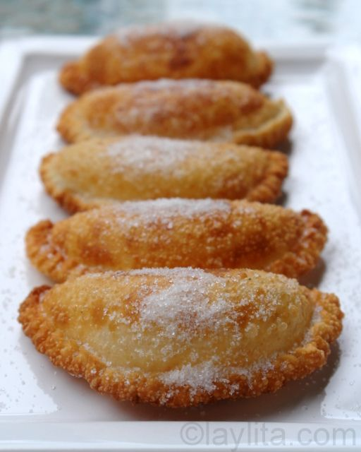 Empanadas de Viento | These are truly my favorite empanadas of all time, the combination of the gooey cheese and onions inside a crispy fried empanada and topped with sugar is delicious. I would eat these every day if I could (probably not a healthy idea), these empanadas de viento are the perfect breakfast or afternoon snack with a hot cup of black coffee. | From: layalita.com