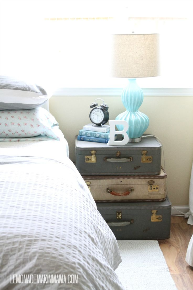 stacked vintage suitcases for a guest room nightstand