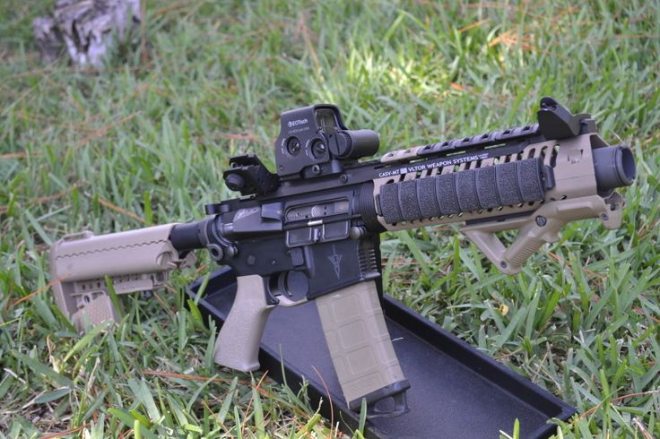 """This is one of my favorite AR-15's that I own.  NFA SBR with a 7.5"""" stainless barrel.  VLTOR upper and lower receiver, and a bunch or dark earth Magpul goodies!  Topped off with a Brownells CQB T-Dot EOTech, Noveske KX-3 and Dueck Defense offset iron sights.  Man is she a shooter!"""