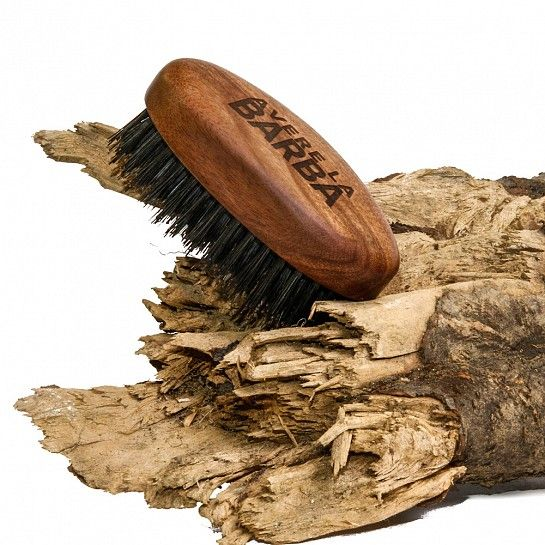 Exquisite Trimmings   Accessories   Grooming   Beard Brush... An oval beard brush made from kotibè wood, with natural bristles of wild boar. It is the next step up from the 'militay brush' and is smaller in size for easier use. This beard brush has been tried and tested specifically for the grooming of the beard. It is suitable for use on all types of beards, from fine or coarse beards, to long or short beards. The natural bristles made from wild boar have a thickening and shining effect on…