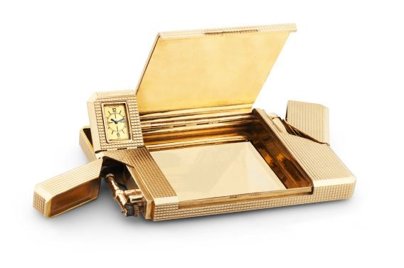 """Jaeger-LeCoultre for Dunhill - Gold Pocket Compendium Jaeger-LeCoultre, """"Vanity"""", movement No. 548705, retailed by Alfred Dunhill, the case by Matteo Cellini """"Bando"""", with London hallmarks for 1949-1950. Fine and very rare, 9K gold pocket compendium with cigarette case, lighter, telescopic pencil, penknife, concealed ivory writing tablet, drill, stamp container, ruler and watch."""