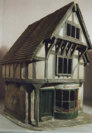The Old Curiosity Shop by Vic Newey. Saw this and his complete Dickensian street scene at the Kensington Festival a few years ago and it's absolutely wonderful. Have been a big fan ever since. He used to work on sets for film and TV and has transferred those skills and techniques to the miniature world. Click to his site to see the street lit and peopled. (can't pin)