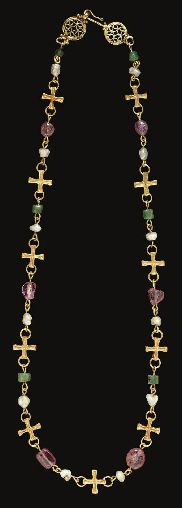 A NECKLACE OF ELEVEN BYZANTINE GOLD CROSSES     CIRCA 7TH CENTURY A.D.