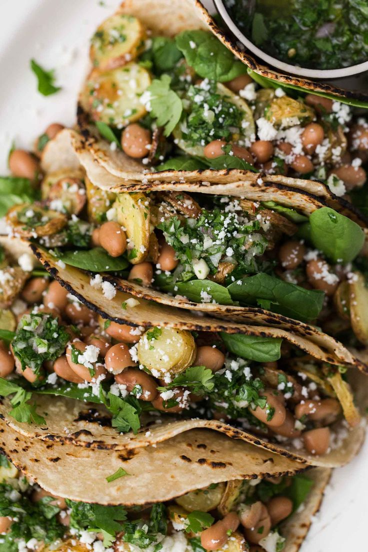 Hearty potato tacos that is tossed with pinto beans and a homemade chimichurri sauce. Perfect for a healthy weeknight dinner.