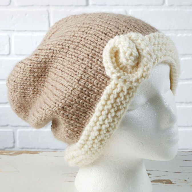 Get stylish for the winter months by knitting this Charisma™ DIY slouchy hat accented with a flower inspired by Loops & Threads®.