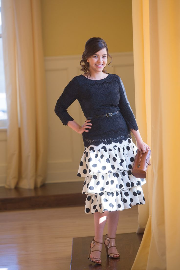Modest black lace blouse with white and black polka-dot ruffle skirt. Modest fashion, ruffles, lace, bridesmaids dresses. www.daintyjewells.com