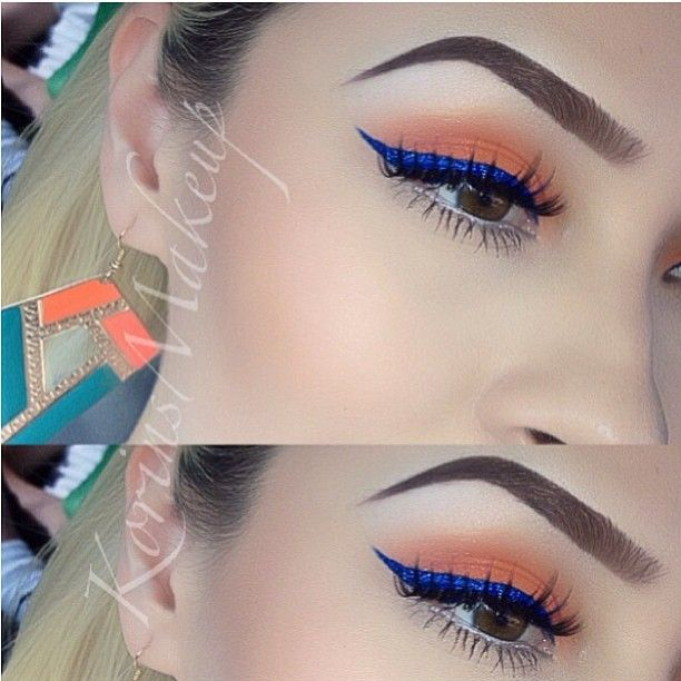 Orange with blue winged liner. (this could be used as a Capitol makeup/costume for a photoshoot)