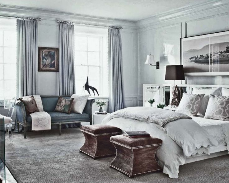 soft blue wall and grey fabric window curtains on the hook connected by white bedding set and double brown wooden benches on the carpet