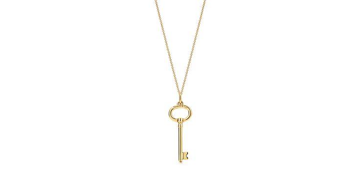 Tiffany Keys oval key pendant in 18k gold on a chain.