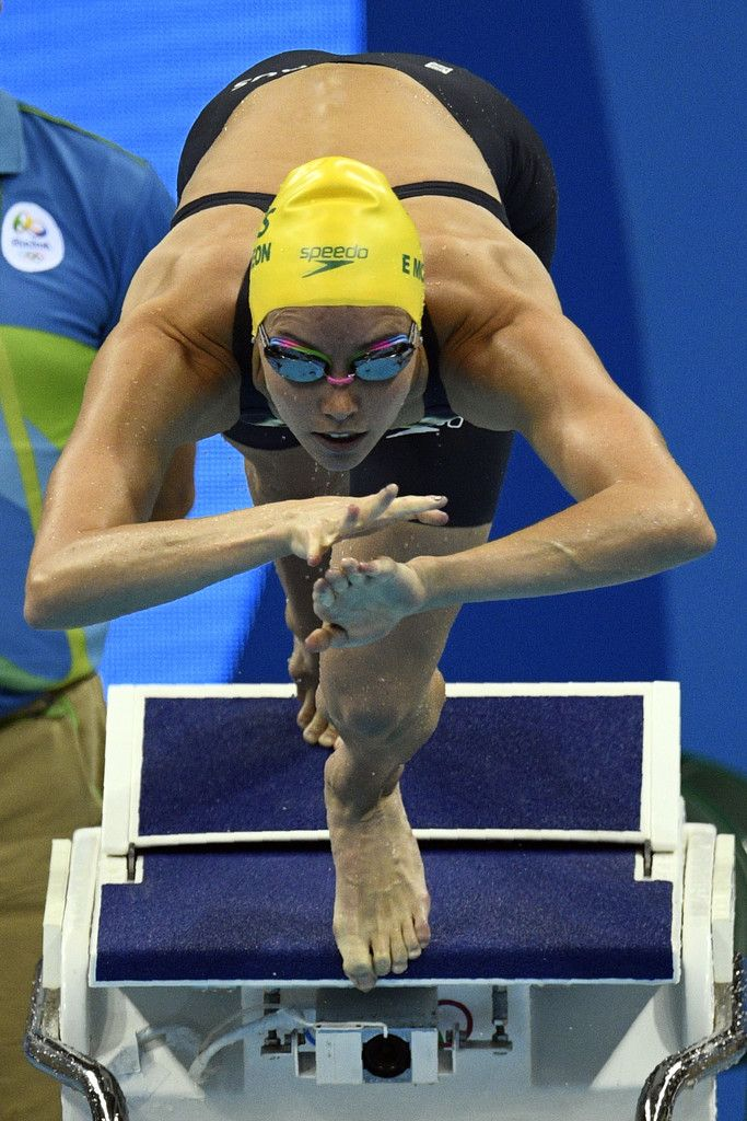 Australia's Emma Mckeon takes part in the Women's 100m Butterfly heat during the swimming event at the Rio 2016 Olympic Games at the Olympic Aquatics Stadium in Rio de Janeiro on August 6, 2016.   / AFP / Martin BUREAU