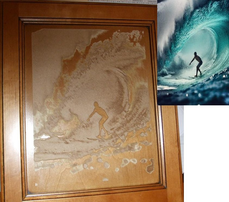 Image cut into a kitchen cabinet door using CNC Router  http://www.rtacabinetmall.com