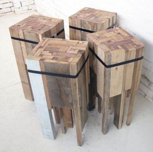 Reclaimed wood scraps banded into stools or end tables. Sanded and finished with linseed oil, putty and wax.