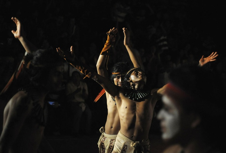 Honduran Ch'orti' of Mayan descent celebrate a point during a Mayan ball game against Guatemalan Quirigua in Copan, on December 18, 2012. This week, at sunrise on Friday, December 21, an era closes in the Maya Long Count calendar, an event that has been likened by different groups to the end of days, the start of a new, more spiritual age or a good reason to hang out at old Maya temples across Mexico and Central America. (Reuters/Jorge Cabrera)