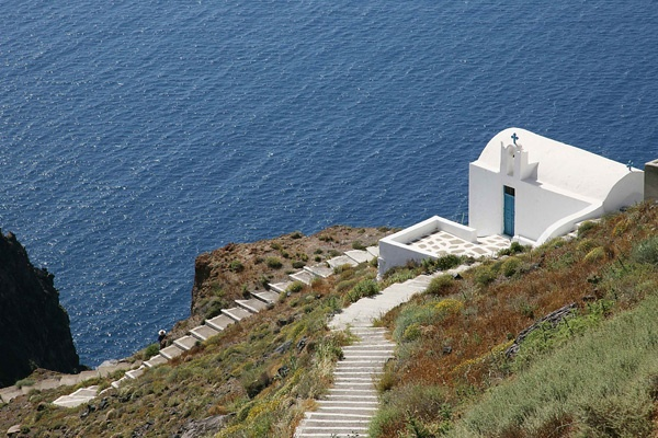 "Tholos Resort Hotel Santorini - The church of  ""Agios Ioannis o Apokefalisthis"" (= St. John the Beheaded). You can also hear the locals refer to it as ""Agios Ioannis o Katiforis"" (= St. John on the way down) as it is on a footpath that goes downhill.  This nice church is in Imerovigli, just a few minutes walking distance from our hotel and has an excellent view of the Caldera and the sea"