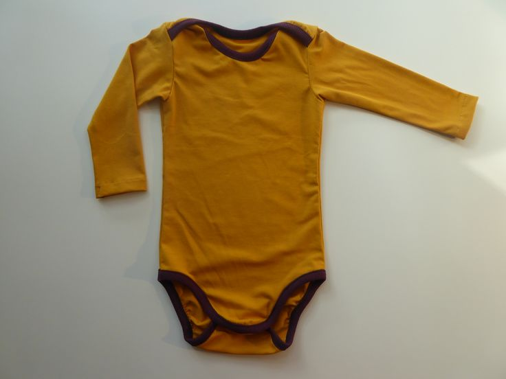 #Unisex #babybody in mustard. The soft #organic cotton piping will feel great on baby's skin.  #barnkläder #babykläder #biokleidung #slowfashionmovement #Pitupiclothing #onesie #Pitupiclothing #cotton #fairtrade #ecofriendly
