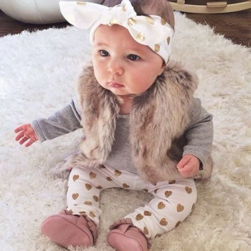 3 Piece Baby Girls Gold Heart Clothing Set. Set includes gray bodysuit, gold heart printed pants, and matching headband. Available for sizes 0-24M Department Na