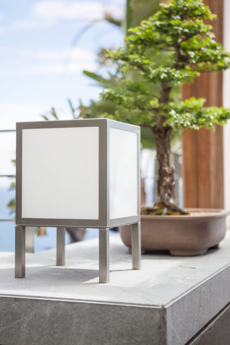 Brushed stainless steel beach lantern with white glass