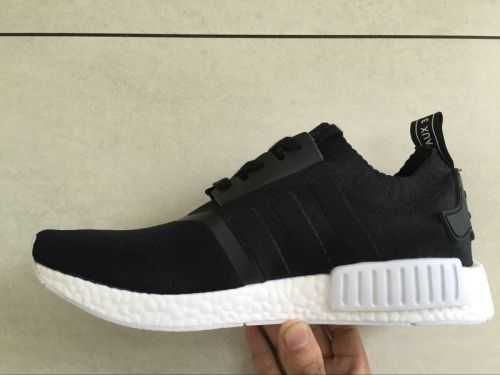 competitive price 13c9b 99069 Real Unisex Adidas NMD R1 Black