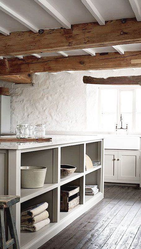 = open shelf island bench, wood beams and country sink