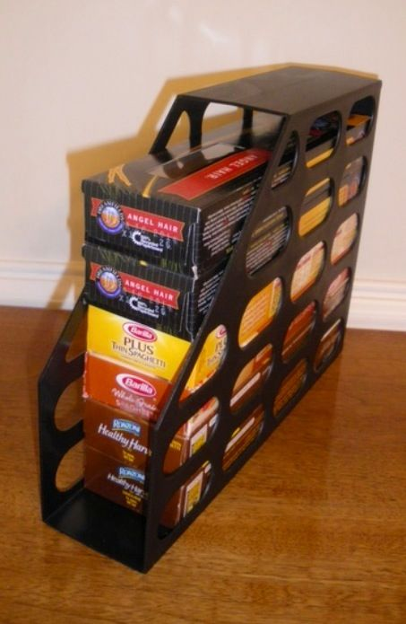 Magazine holders turned to make pasta box stacking easy in the pantry