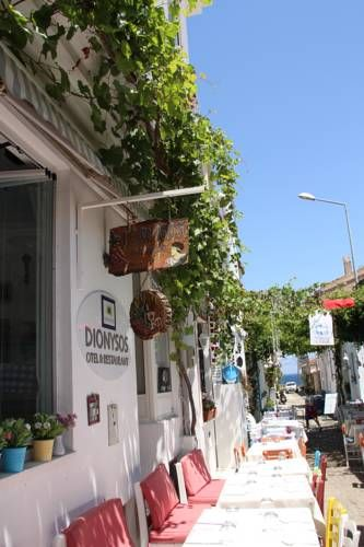 Dionysos Hotel Bozcaada Dionysos Hotel is located in Bozcaada, 46 km from Canakkale and 44 km from Behramkale. Guests can enjoy the on-site restaurant.  All rooms are equipped with a flat-screen TV. All rooms are fitted with a private bathroom.