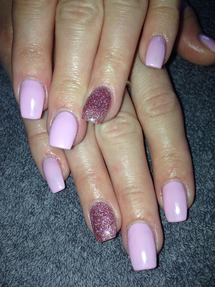Acrylic extensions with pink gel polish (IBD Juliet) and purple glitter.