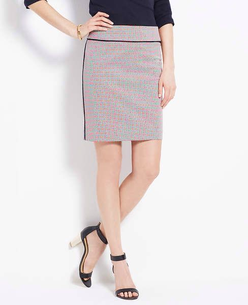 small scale print pencil skirt with piping at side seam and waistband.