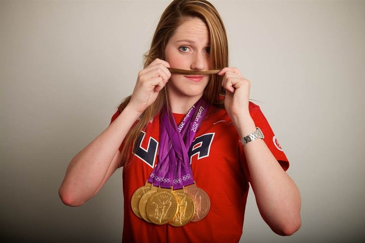 Swimmer Missy Franklin makes a mock mustache as she dispalys her five medals on on August 6, 2012. The 17-year old U.S. swimmer won four gold medals and a bronze.