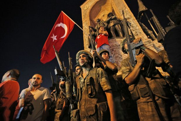 Turkish soldiers secure the area, as supporters of Turkey's President Recep Tayyip Erdogan protest in Istanbul's Taksim square, early Saturday, July 16, 2016