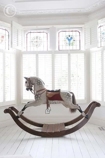 Beautiful antique-style rocking horse.. My childhood love of horses and riding started with one of these! I want one...