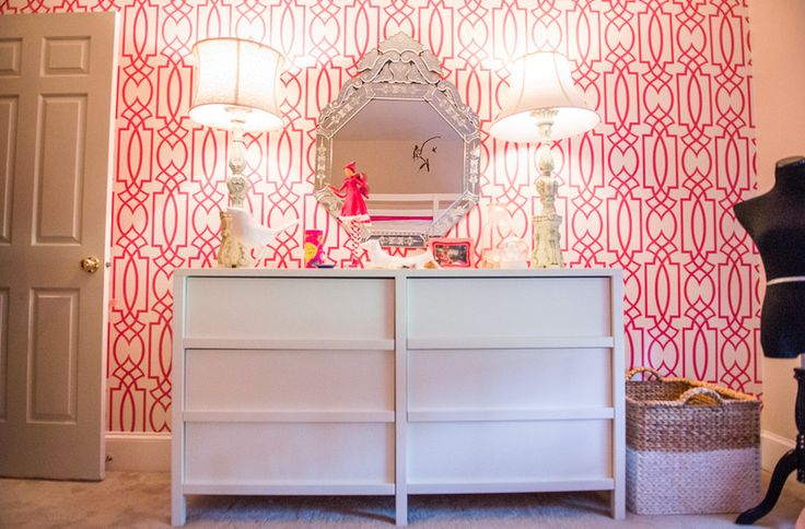 Bold Pink lines wallpaper accent wall in a child's bedroom with furniture with clean white