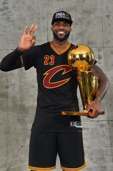 LeBron James of the Cleveland Cavaliers poses for a portrait with the World Championship Trophy after winning the NBA Championship against the Golden...