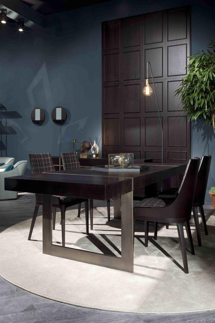 This contemporary table is beautifully made using mocha Ash wood incorporating a metal leg structure. Would suit any modern interior design in a dining room or contemporary dining kitchen. The Large High End Modern Italian Designer Dining Table at Juliette's Interiors, amongst a large collection of contemporary furniture.