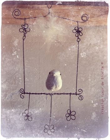 Just place a needle felted bird on this simple wire hanging.