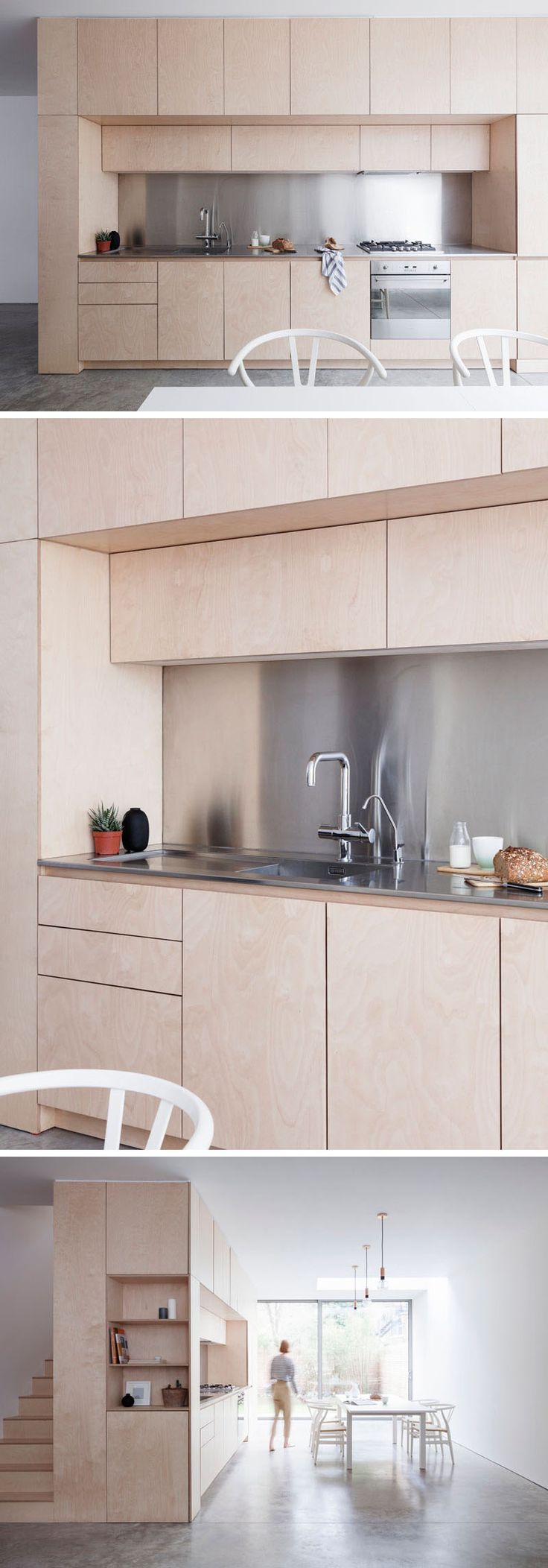 Light wood cabinets with stainless steel countertops and backsplash give this kitchen a contemporary design