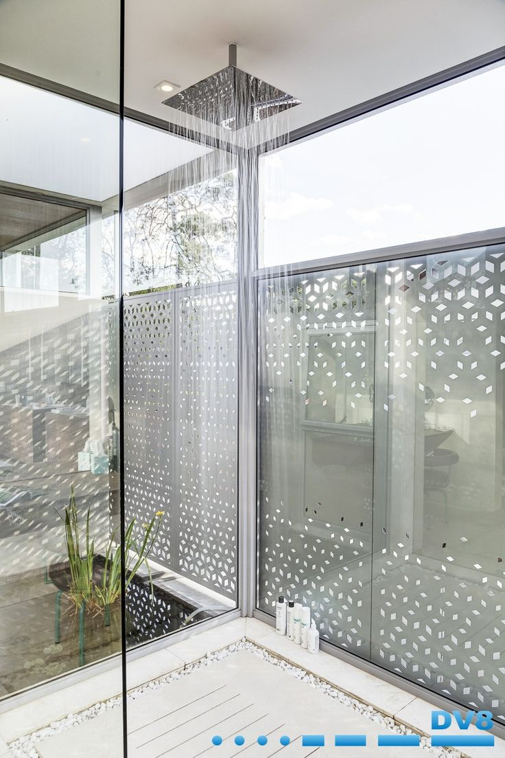Water shower. Shower with water feature on either side. Screens provide privacy and interplay of light and shadow. Wabi Sabi.