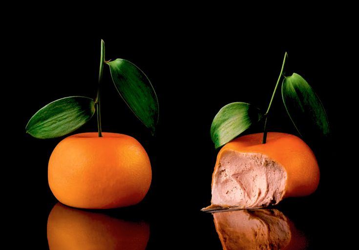 Historic Heston - Meat Fruit with parfait spheres of fois gras, mandarin jelly, and herb oil by chef Heston Blumenthal.